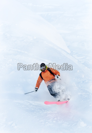 freeride skier in powder snow