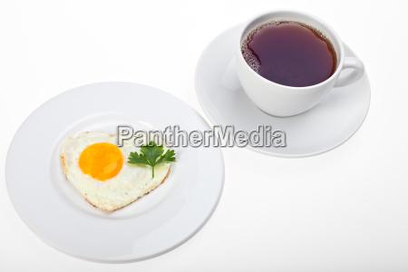 heart shaped fried egg and a