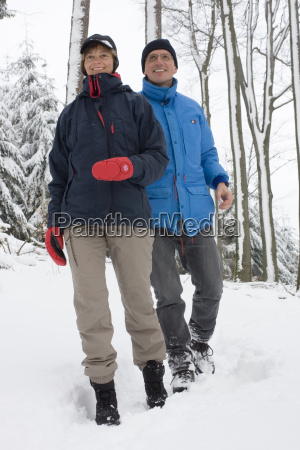 couple hiking in the snow
