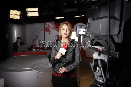 reporter with braking news in studio