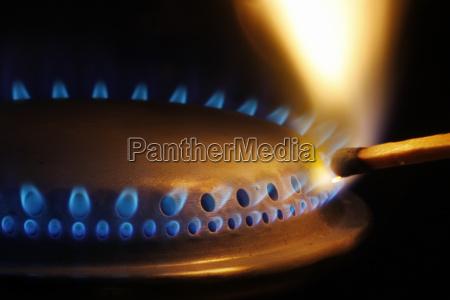 match ignites gas stove