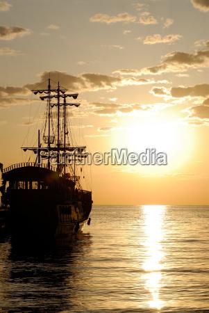 pirate ship on background sunrise