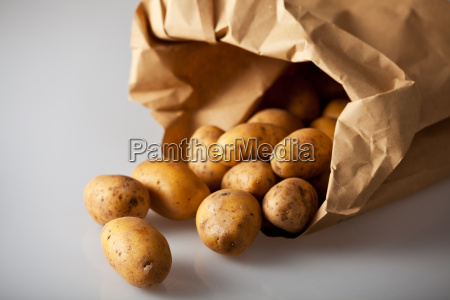 fresh potatoes in a brown paper