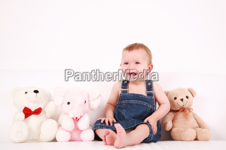 lovely baby girl with toys