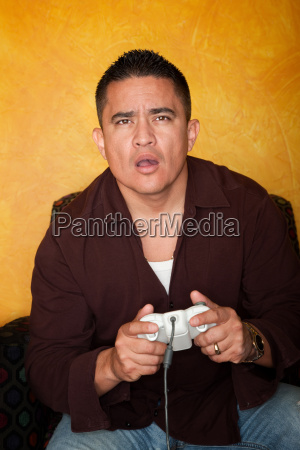 handsome hispanic man playing video game