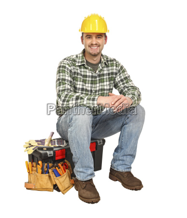 young manual worker and toolbox