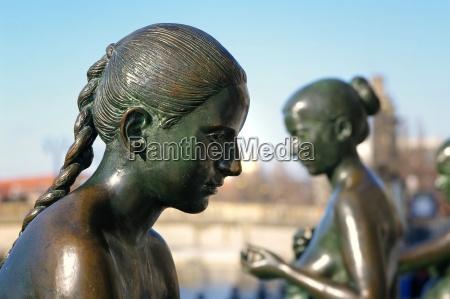 womans head in profile bronze sculpture