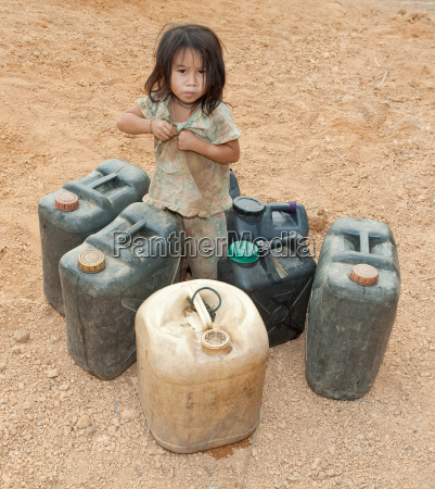 asian child with gasoline canister
