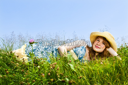 young, girl, laying, in, meadow - 2814693