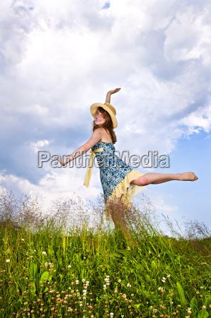young, girl, dancing, in, meadow - 2817141