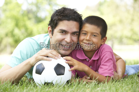 father and son in park with