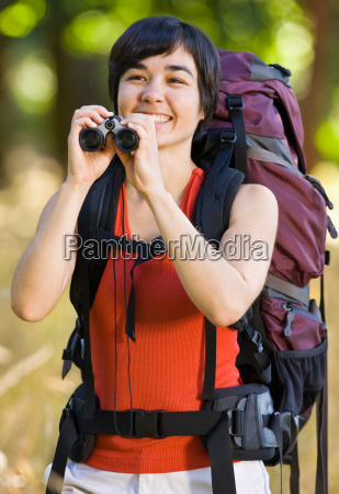 woman with backpack and binoculars
