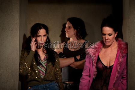 frightened, prostitutes, in, hallway, with, pimp - 2822917