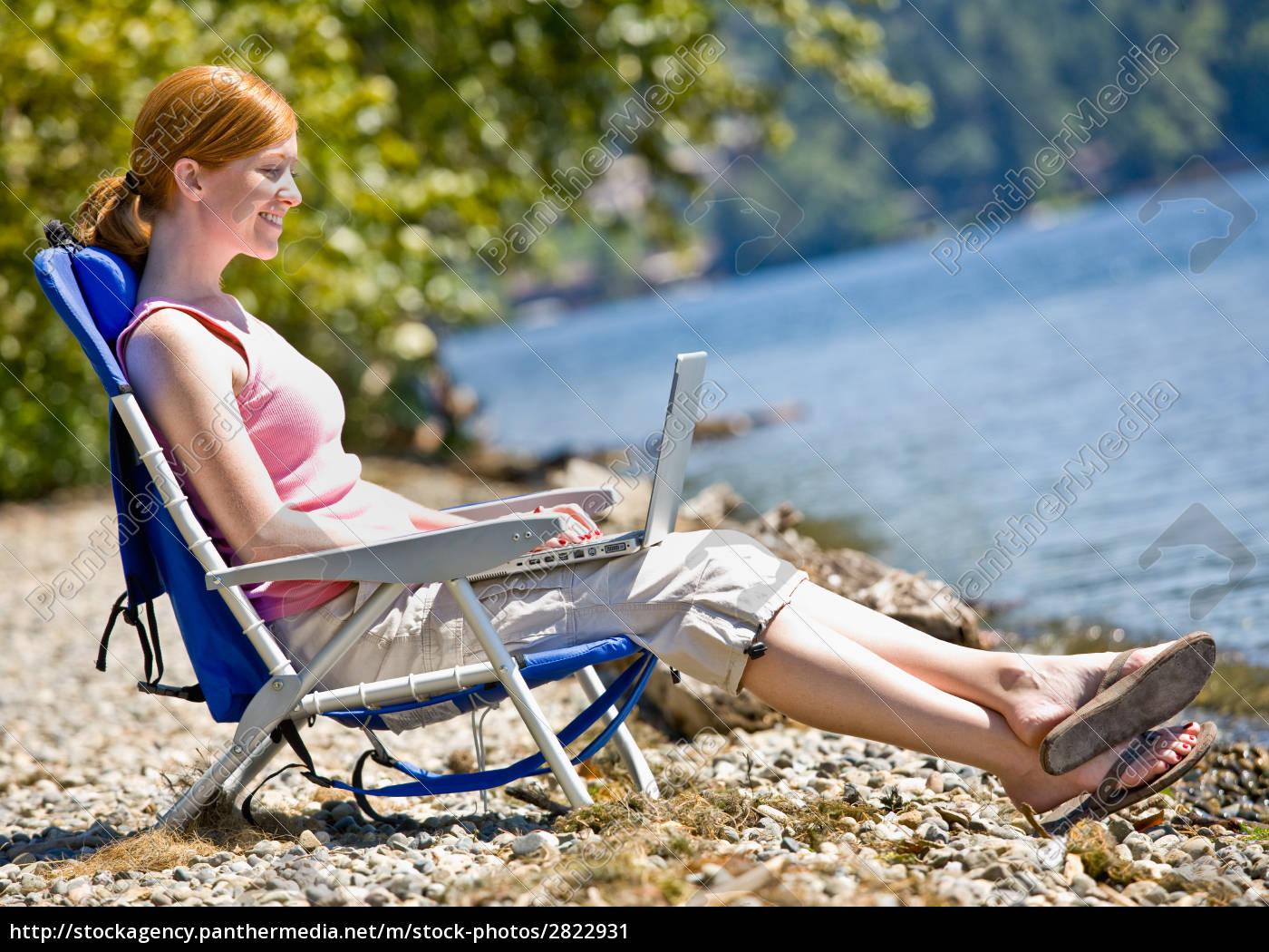 woman, using, laptop, near, stream - 2822931