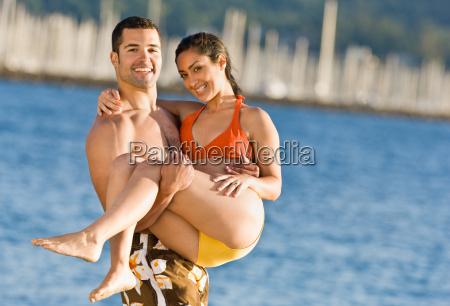 boyfriend, carrying, girlfriend, at, beach - 2823885