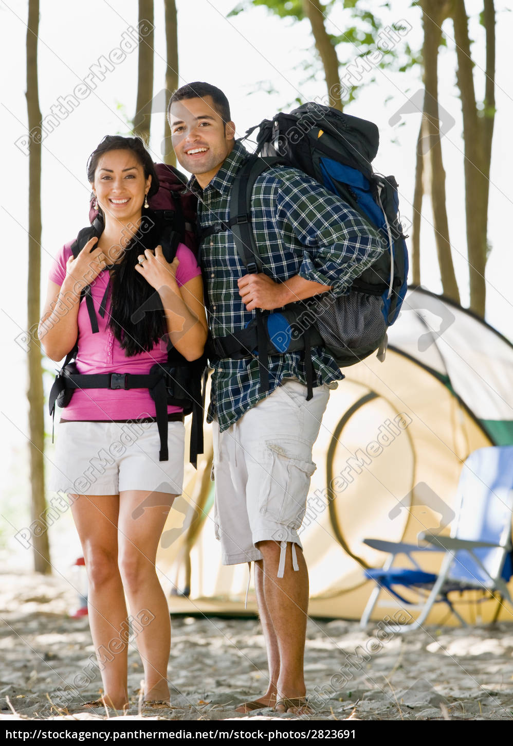 couple, carrying, backpacks, at, campsite - 2823691
