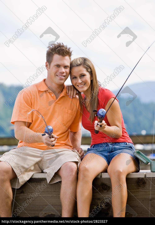 couple, fishing, on, pier - 2823327