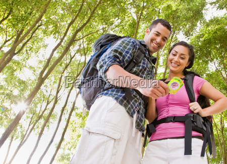 couple, in, backpacks, looking, at, compass - 2823647