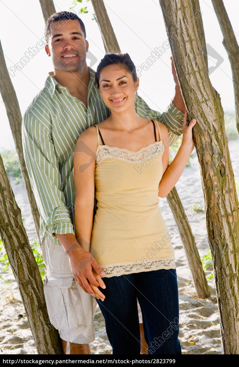 couple, leaning, on, tree, at, beach - 2823799