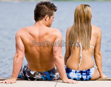 couple, sitting, on, pier - 2823235