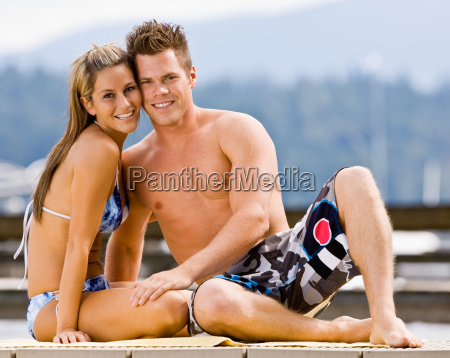 couple, sitting, on, pier - 2823535