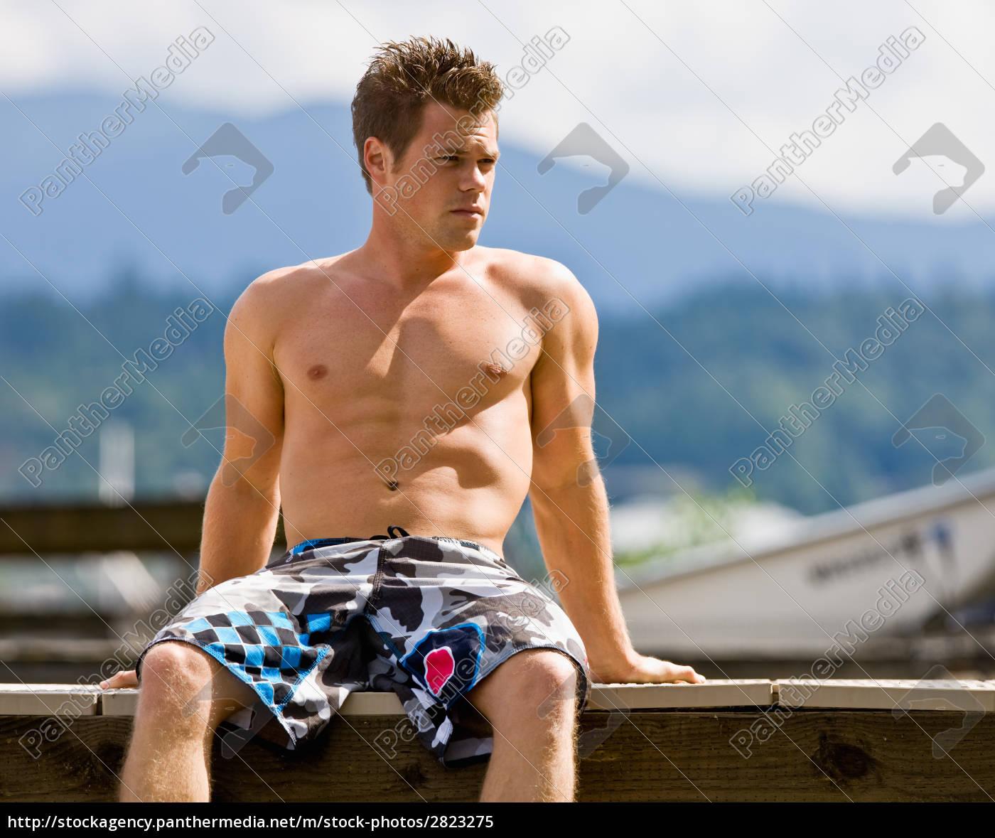 man, sitting, on, pier - 2823275