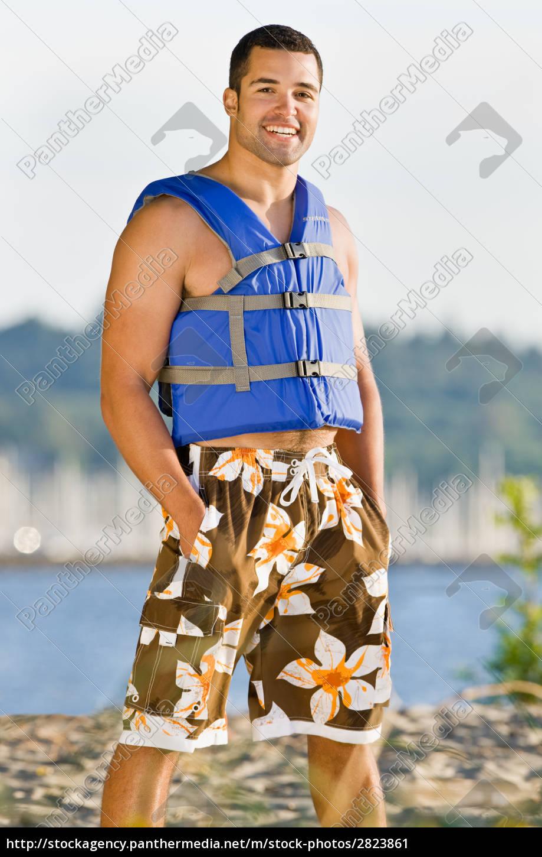 man, wearing, life, jacket, at, beach - 2823861