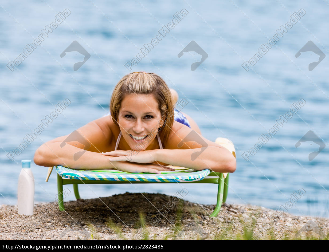woman, laying, on, lounge, chair, at - 2823485