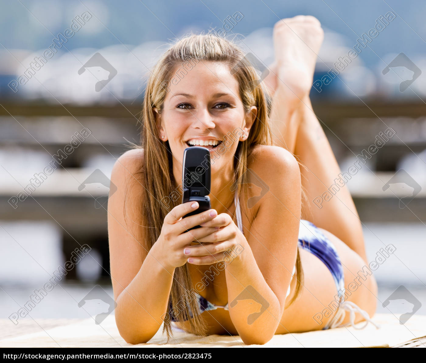 woman, laying, on, pier, text, messaging - 2823475