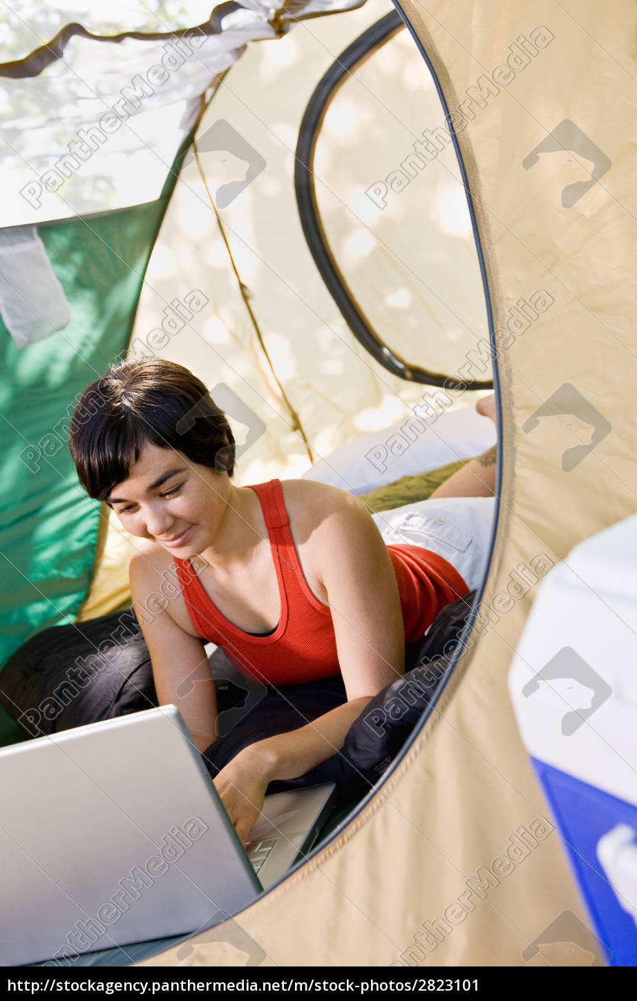 woman, using, laptop, in, tent - 2823101