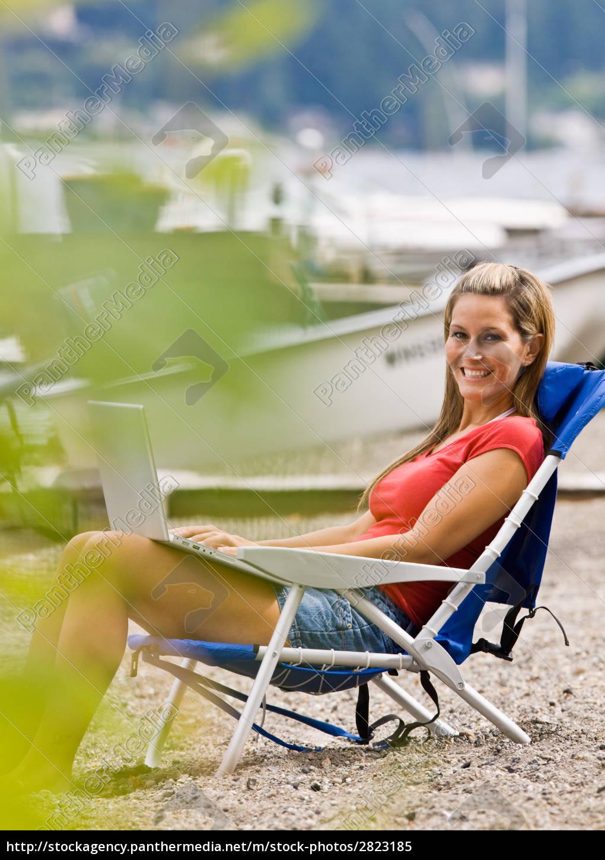 woman, using, laptop, on, beach - 2823185