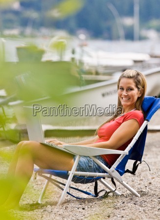 woman, using, laptop, on, beach - 2823185