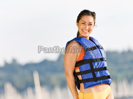 woman, wearing, life, jacket, at, beach - 2823423