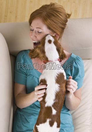 dog licking woman