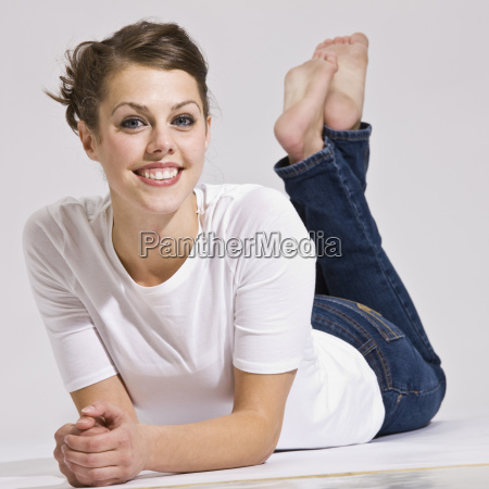 attractive woman lying down and smiling
