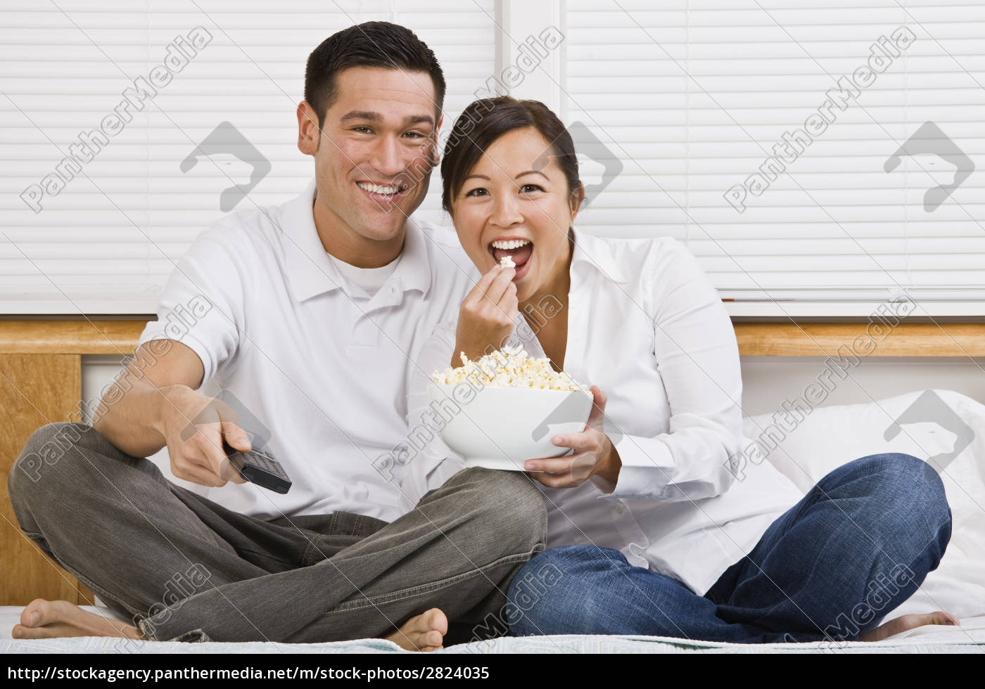attractive, asian, couple, eating, popcorn, in - 2824035