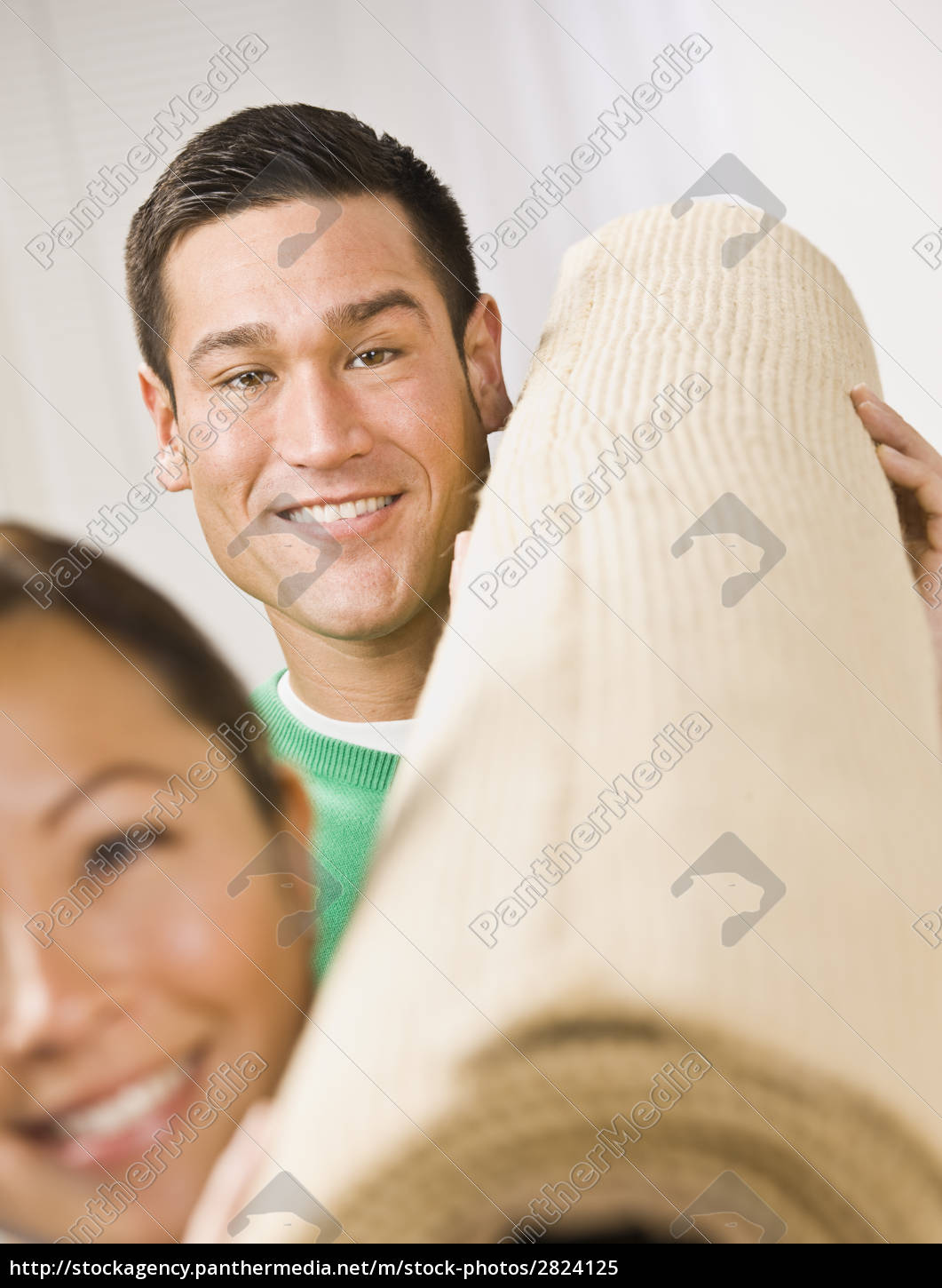 attractive, couple, with, roll, of, carpet - 2824125