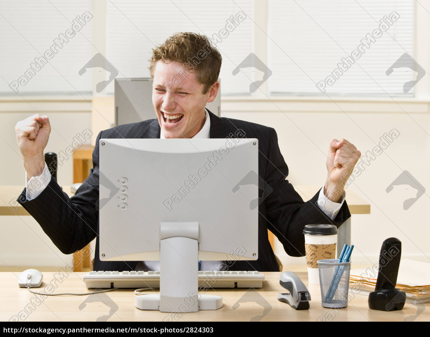 businessman, cheering, at, desk - 2824303