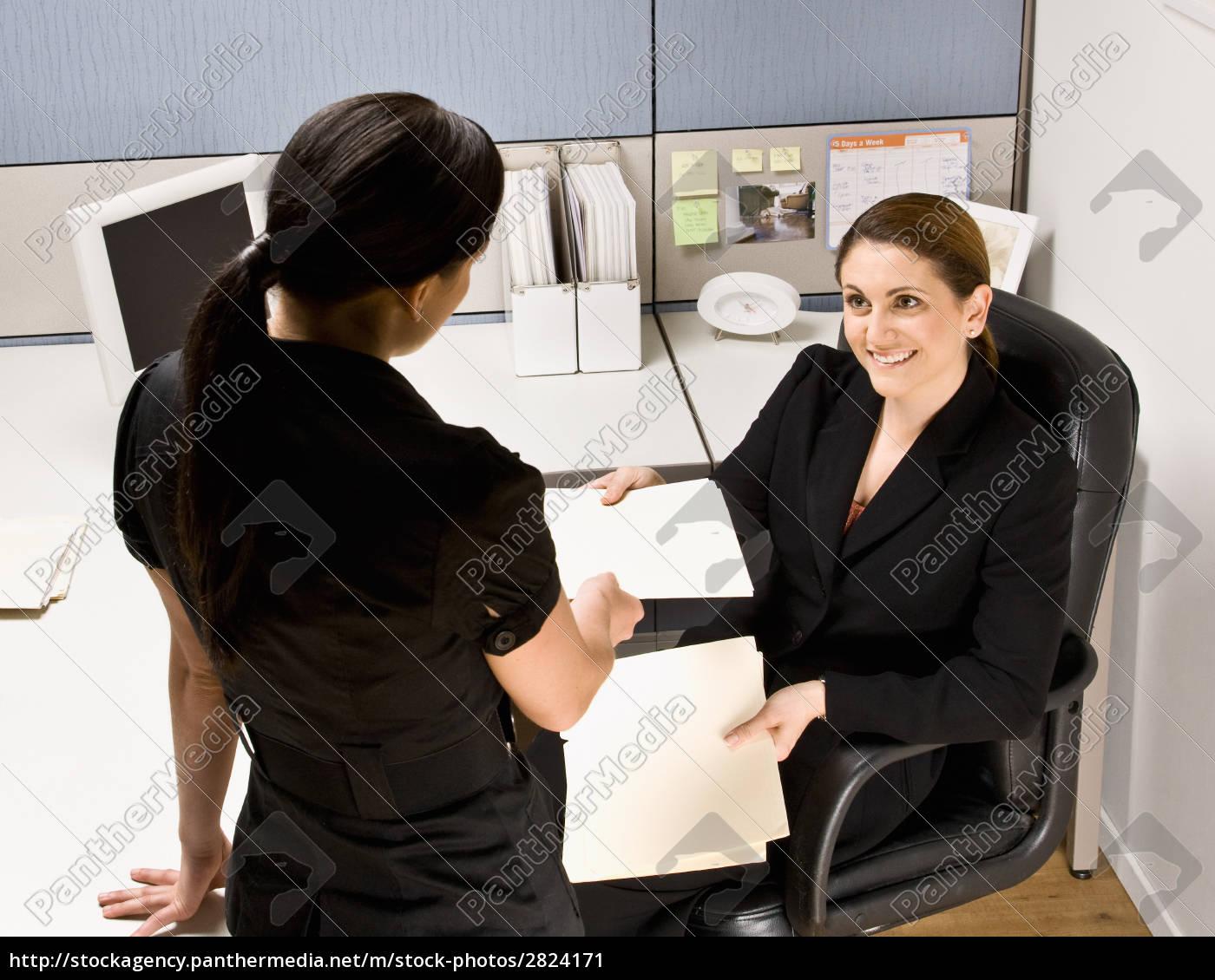 businesswoman, handing, co-worker, file, folder - 2824171