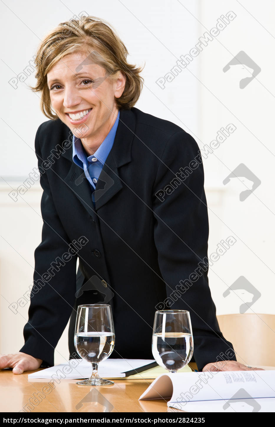 businesswoman, leaning, on, table - 2824235