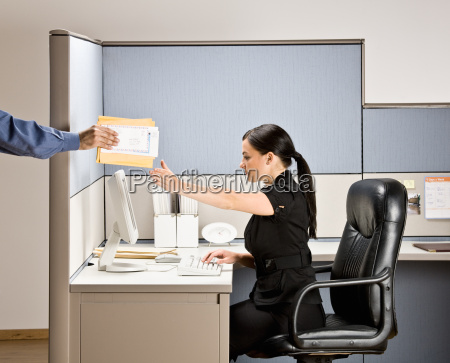 businesswoman, multi-tasking, at, desk, in, cubicle - 2824199