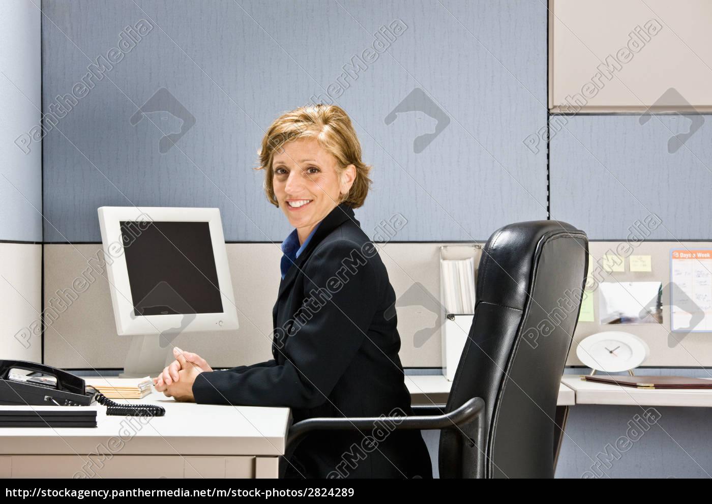 businesswoman, sitting, at, desk - 2824289
