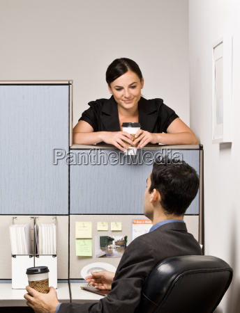 co-workers, talking, in, office, cubicle - 2824213