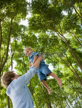 father, lifting, son, outdoors - 2824021
