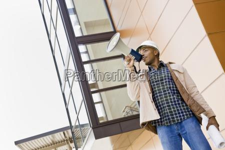 male, construction, worker, using, bullhorn - 2824425