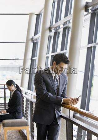 young, businessman, texting - 2824395