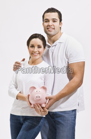 attractive young couple with piggy bank