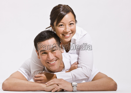 attractive young couple posing on floor