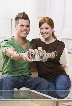 happy young couple with present