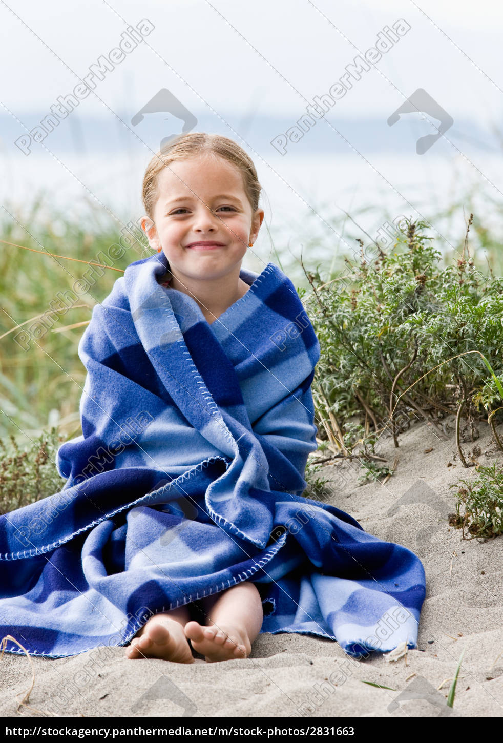 girl, wrapped, in, blanket, at, beach - 2831663